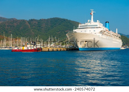view of a large cruise passenger liner in the sea port - stock photo