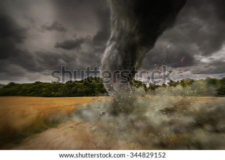View of a large tornado destroying the landscape - stock photo