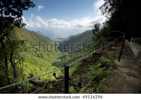 View of a levada from an hiking trail - stock photo