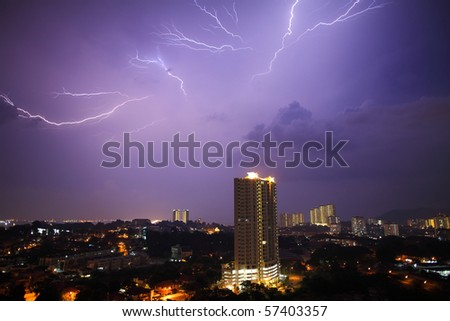 View of a lightning over city at night. - stock photo