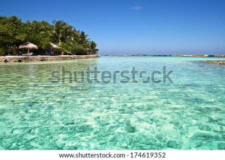 view of a little island in the Ari Atoll - stock photo