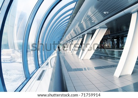 View of a long corridor in airport - stock photo