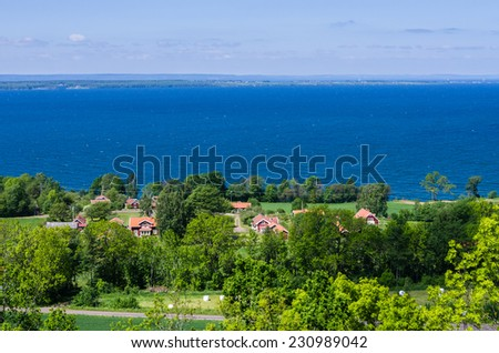 View of a lush landscape and a lake.
