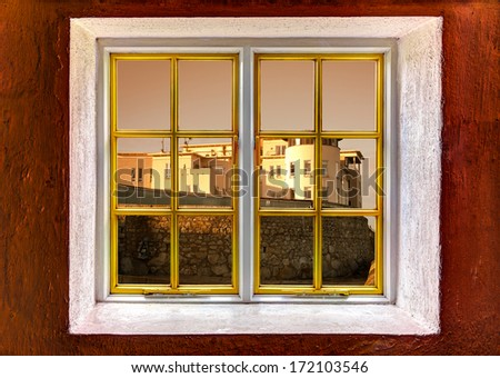 View of a mansion through a window - stock photo