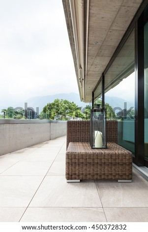 View of a modern balcony with comfortable garden furniture