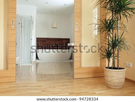 View of a modern en suite bathroom from a bedroom. - stock photo