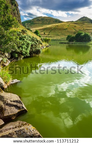 View of a mountain lake at the saint Patrick Day's - stock photo