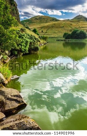 View of a mountain lake in summer - stock photo