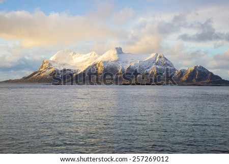 View of a Norwegian fjord with snowy mountain, Nordland, Norway - stock photo