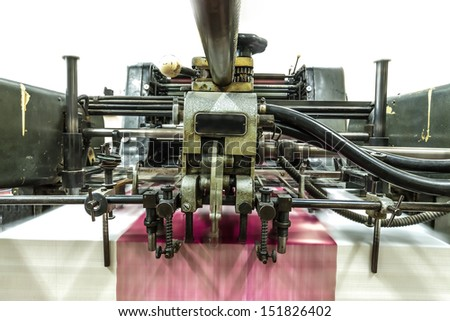 View of a part of a machine in a paper industry. It shows part of machine in work process.  - stock photo