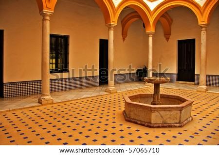 view of a patio in Alcazar of Seville, in Spain - stock photo