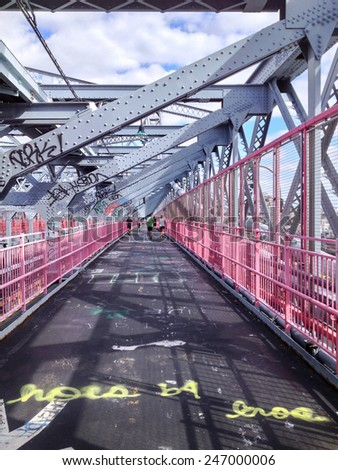 View of a pedestrian walkway on the Williamsburg Bridge in New York, NY, USA. - stock photo
