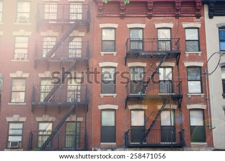 View of a red building in New York. - stock photo