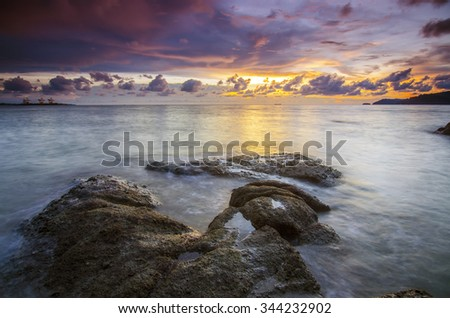 View of a rocky coast during sunset. Long exposure shot.