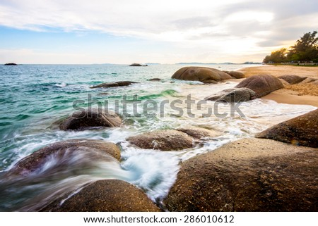 view of a rocky coast in the morning. - stock photo