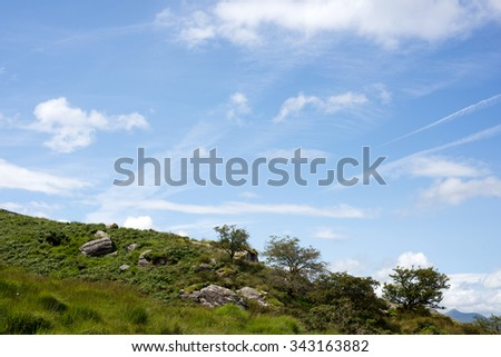 view of a rocky landscape on a beautiful hiking route the kerry way in ireland - stock photo