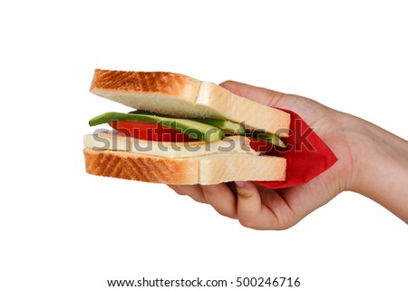 View of a sandwich with cheese, tomato and cucumber holding on hand, isolated on white background.