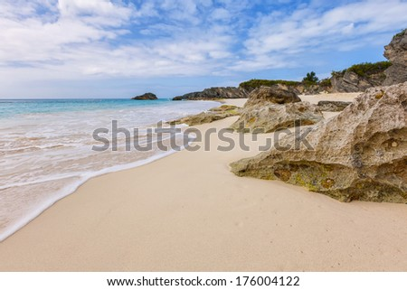 View of a secluded beach of pink sand on the south shore of Bermuda. - stock photo