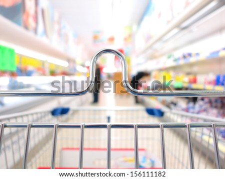 view of a shopping cart trolley at supermarket - stock photo