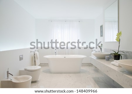 View of a spacious and elegant bathroom - stock photo