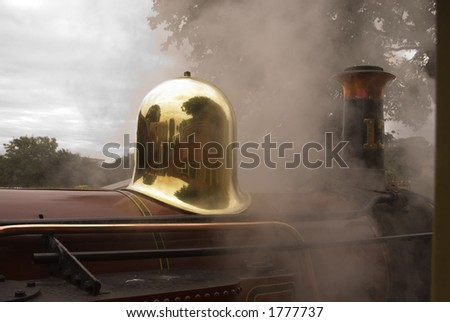 view of a steam locomotive on the isle of man narrow gauge railway from inside a car on a second train - stock photo