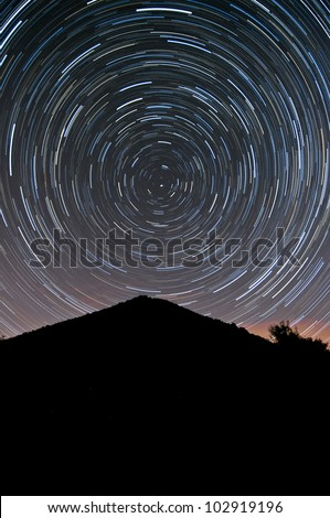 View of a stratrails on the night sky. - stock photo