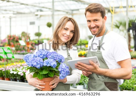 View of a Team of florist working together at the plants nursery