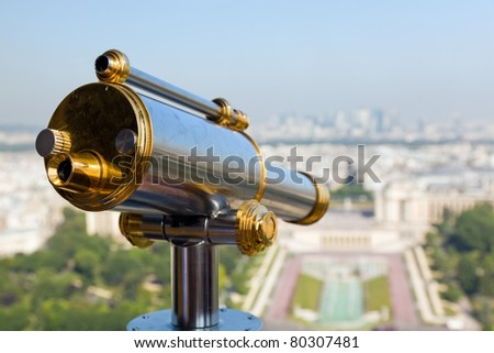 View of a telescope from high up on the Eiffel Tower