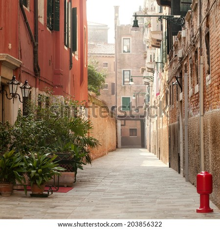 View of a typical narrow Venice street, square composition - stock photo