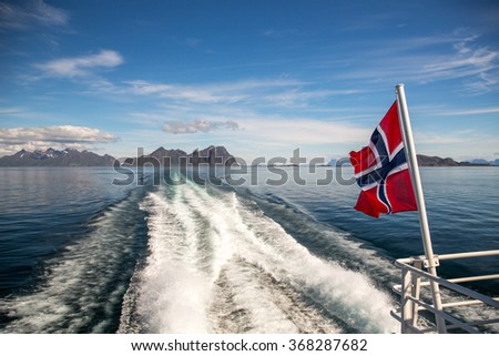 View of a typical norwegian landscape from a moving boat.