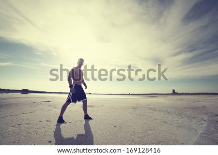 View of a very fit male model with muscles.Fashion photo.Fine art.  - stock photo