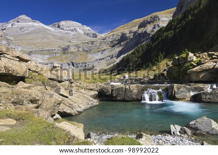 view of a waterfall and Monte Perdido peak in the valley of ordesa, Pyrenees, Huesca, Aragon, Spain - stock photo