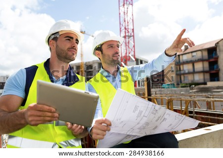 View of a Worker and architect watching some details on a construction - stock photo