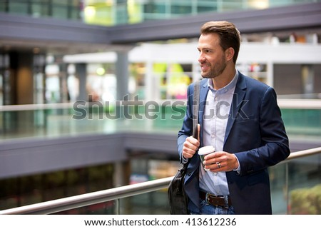 VIew of a Young attractive business man drinking coffee - stock photo