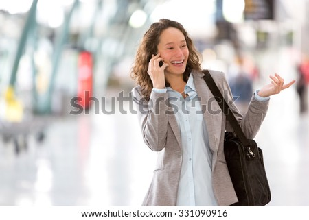 View of a Young attractive business woman using smartphone