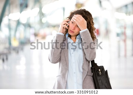 View of a Young attractive business woman using smartphone - stock photo