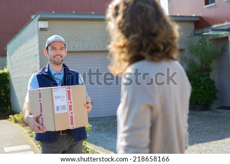 View of a Young attractive delivery man on his way to customer - stock photo