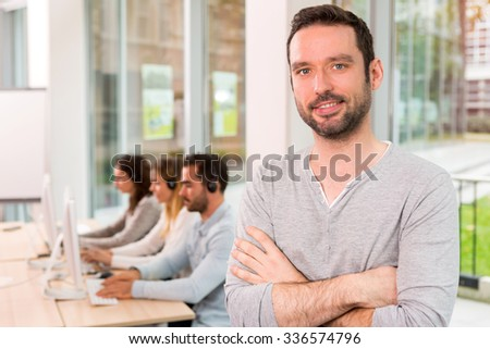 View of a young attractive man at work - stock photo