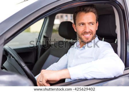 View of a Young attractive man driving his car - stock photo