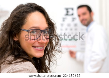 View of a Young attractive woman doing optician test - stock photo