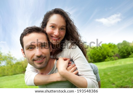 View of a Young happy couple having fun at the park