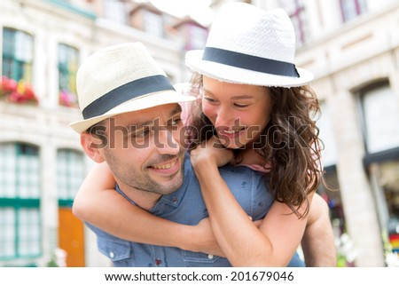 View of a Young happy couple having fun on holidays - stock photo