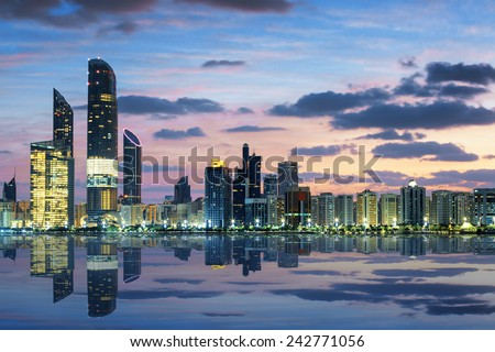 View of Abu Dhabi Skyline at sunset, United Arab Emirates  - stock photo