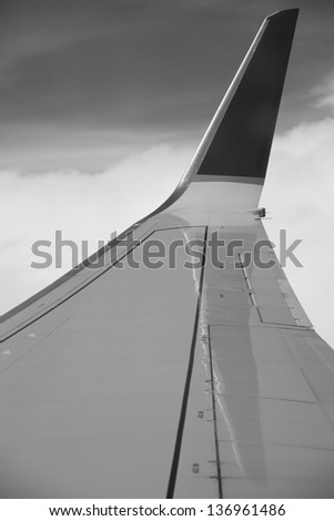 View of airplane wing from passenger window - stock photo