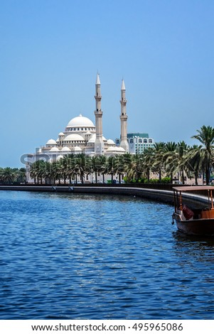 View of Al Noor Mosque in Khalid Lagoon in Sharjah city. Sharjah located along northern coast of Persian Gulf on Arabian Peninsula. United Arab Emirates.