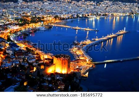 View of Alanya harbor form Alanya peninsula. Turkish Riviera by night - stock photo