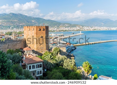 View of Alanya's port with the Kizil Kule (Red Tower) - stock photo