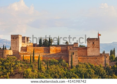 View of Alkhambr's fortress on a sunset, Granada, Spain - stock photo