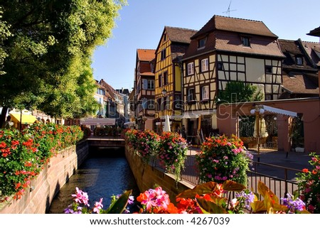 View of Alsace typical traditional street (Colmar, France) - stock photo