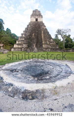 View of altar with the ancient Mayan pyramid 'Temple of the Great Jaguar or Temple 1' in background in Tikal, Guatemala, Central America. - stock photo